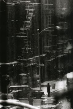 snow-covered fire escape with street traffic