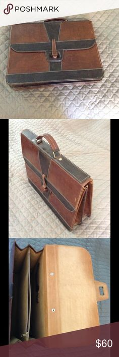 Leather briefcase with 2 sections Really nice briefcase with slide in closure. Brown and black leather. 2 sections with zipper in the middle.  Has some small natural wear on it. No cross body strap only a traditional handle.  About 17in wide x 12.5in hieght x expands to 6in deep. Bags Briefcases