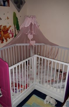 Neat unique crib set up for twins or babies close together both requiring cribs at the same time