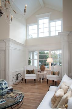 Soaring beamed ceilings, a wall of windows, in this elegant nook. Construction, design, interiors and more. Custom homes by KellyBaron Design. http://www.kellybaron.com/home