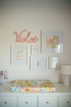 A pretty pop of floral! | Mini Gallery Wall Over the Changing Table