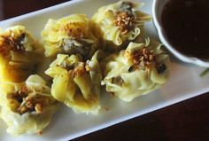 Tulip dumplings at Royal Thai restaurant on Greenville Avenue; frilly wrappers filled with gingery pork, shrimp and water chestnut, then steamed and served with a soy-based dipping sauce