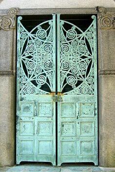 Ornate mausoleum door. - by nonnyV
