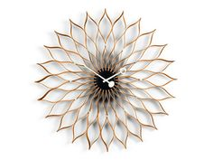Nelson Sunflower Clock, designed by George Nelson.The Nelson clocks were first born from a festive evening of collaboration. George Nelson recalls: 'And ther George Nelson, Vitra Design Museum, Rolled Paper Art, Quartz Clock Movements, Toilet Paper Roll Crafts, Messing, Washi, Home Accessories, Modern Design