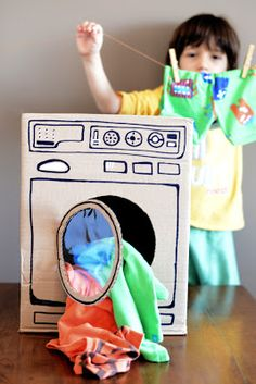 DIY Washing machine out of a cardboard box! Excellent idea to keep children occupied and stay way under budget.too cute for my daughter she loves messing with clothes (And I would put a basket inside of it, to teach the kids to put their dirty clothes in the basket! -Tal)