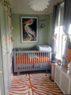 A small space doesn't have to have small art, this contemporary boy's nursery has big style thanks to this surprising picture! The pelican print unifies and calms the competing lines of the chevrons and animal print, whilst adding it's own straight edges to the mix!
