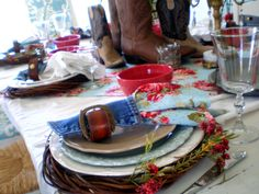 Example of Food Set-Up: Western Table setting. I really like the mismatched plates and old boots! Cool take on a western theme!