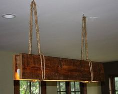 5 foot Reclaimed Wood beam Chandelier by UniqueWoodIron on Etsy