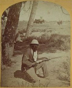"""1873 of Bloody Knife, Custer's favorite Indian Scout for his 7th Calvalry. He is posed holding his Winchester """"Yellowtail"""" Repeating Rifle and wears a U.S. Army jacket with the chevron of a corporal."""