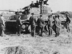 Soldiers gathering around a Tiger 1 while serving on the Eastern Front