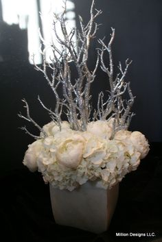 Million Designs winter white holiday floral arrangement with peonies, hydrangea and silver glittered branches. Winter Wedding Centerpieces, Christmas Centerpieces, Diy Wedding Decorations, Floral Centerpieces, Christmas Decorations, Winter Flower Arrangements, White Floral Arrangements, Christmas Floral Arrangements, Christmas Flowers