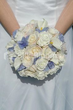 Google Image Result for http://www.silkblooms.co.uk/images/bride/gemma_cornflower_blue_rose_bridal.jpg