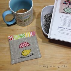 Sweet Tweets little coaster with hand quilting and all.