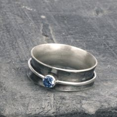 Oxidized sterling Silver spinner ring with a blue aquamarine