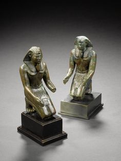 Two Egyptian bronze figures of kneeling Pharaohs. Ptolemaic Period, circa 332-30 B.C.