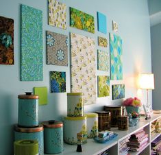 This is a great way to incorporate a desired color scheme and decor with minimal cost. Buy fabric in the clearance bin, and cover cheap frames from goodwill in different sizes. If you want to make it more functional, buy a roll of cork covering and layer it under the fabric so you can pin pictures and quotes on the colorful installments.