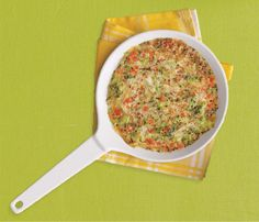 Vegetable Frittata    Heat broiler. In a bowl, combine 1/3 cup cooked quinoa, 1/2 cup frozen chopped broccoli (thawed), 1/3 cup diced red bell pepper, 1/4 cup (1 oz) shredded Swiss cheese. In another bowl, beat 1 egg, 2 egg whites; stir into quinoa mixture. In a medium broiler-safe skillet, heat 1 tsp olive oil; cook egg-quinoa mixture without stirring, 3 minutes. Broil until egg is set, 2 minutes.  THE SKINNY  355 calories, 19 g fat (7 g saturated), 22 g carbs, 5 g fiber, 26 g protein