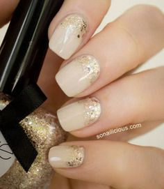 So sparkly! Maria, the editor behind So Nailicious, nailed this part half-moon, part ombré design. Get the tutorial from So Nailicious »