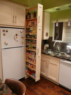 The narrow cabinet beside the fridge pulls out to reveal a spice & canned goods pantry.