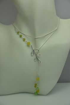 Light green stones  and silver leaf lariat