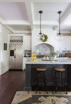 Love the mixing of shaker cabinet color between in this upscale kitchen remodel
