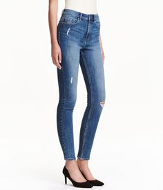 Check this out! 5-pocket, ankle-length jeans in stretch denim with heavily distressed details, ultra-slim legs, and a high waist. - Visit hm.com to see more.
