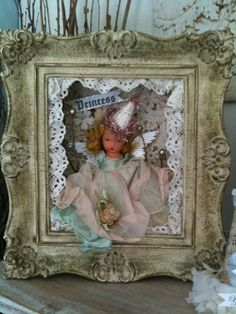 This is what I should do with that box of vintage dolls.  Love the idea.