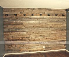 Pallet Wall Idea! Custom Man Cave / Jam Room / Music Room / Bar / Game Room. I made this wooden rustic pallet wall for my husband to hang all of his electric guitars on!