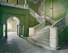 A grand marble staircase at the Yankton State Hospital in South Dakota, once home to hundreds of mentally ill patients