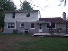 Back view of newly painted siding and white washed brick