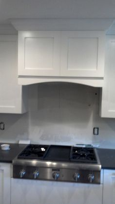 Contemporary wall mount proline range hood install by Ivy League ...