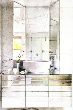 Amazing bathroom with mirrored vanity and stone vessel sink