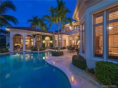 Golf estate home pool and outdoor living at night