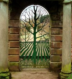 "Norton Priory, Cheshire, England. ""Tree of Life"" gate to the Walled Garden.  The Walled Garden was built by the Brooke family at Norton Priory between 1757 and 1770. The property was owned by the Brooke family for 400 years, but fell into disrepair when the Brookes left. The 2-1/2 acre garden was restored in 1980 to its original grandeur and now features an orchard, a vegetable garden and a rose garden."