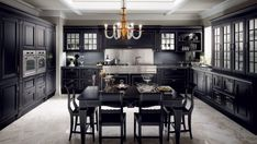 Exquisite combination of black and silver in the traditional kitchen - Decoist Black Kitchen Cabinets, Black Kitchens, Home Kitchens, Wooden Kitchens, Italian Kitchens, Scavolini Kitchens, Kitchen Installation, Kitchen Themes, Cuisines Design
