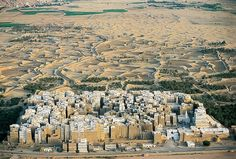 """City of Shibam. Built in the 1500s, Shibam, Yemen, has been nicknamed """"the Manhattan of the Desert"""" for the lessons it offers in vertical urban planning, only it's not built from steel but sun-dried mud brick."""