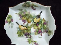 Goldfinches and berries on porcelain by porcelain artist and china painting teacher, Charlene Whitler