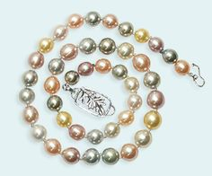 """Shimmering pastel, natural-color pearls cultured around the world make up this beautiful necklace. Golden pearls from Indonesia, pink and peach from China, grey, green, black and silver from Tahiti and white pearls from Australia, remind us of the """"Promise of Spring,"""" by Eve."""