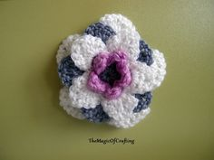 This very simple flower was made to fit one amazing spring hat. It could be used as a nice finish touch to many crochet project - hats, ...