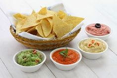 tortilla chips with four super bowl dips which are salsa roja guacamole taramasalata and hummus. Best Dip Recipes, Diet Recipes, Cooking Recipes, Healthy Recipes, Party Dips, Easy Dips To Make, Baby Shower Food Easy, Super Bowl Dips, Flat Belly Foods