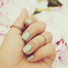 Three Small Dots Finger Tattoo
