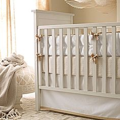 mocha crib bumper and skirt - I love mixing this neutral bumper/skirt with graphic prints on sheets/blanket/rug, etc because you can use for the next child/children regardless of their gender! @Laura Johnson