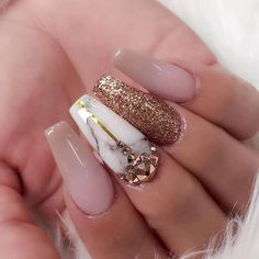 Marble nail art with pink and gold glitters on acrylic nails