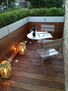 Small roof terrace with planters, lighting & bottle of wine!