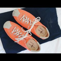 Prada leather 'Car Shoe' Gently worn Prada 'car shoe.' Size 35.5. Orange leather low-top sneakers with contrast stitching and silver-tone hardware, rubber bumper heels and front lace-up closures. Prada Shoes Sneakers