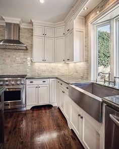 love all the elements in this kitchen - backsplash - cabinets - floor - sink - all