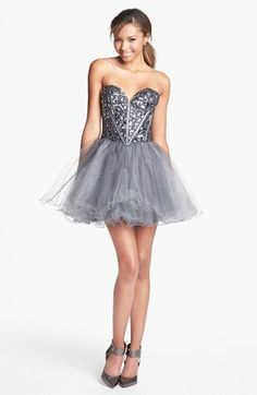 tulle fit and flare.  I like the gems and seams/boning? on the bodice
