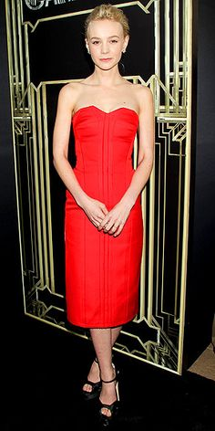 CAREY MULLIGAN The belle of the The Great Gatsby ball stuns in a strapless red Lanvin dress and Brian Atwood platform sandals at the N.Y.C. premiere of the hotly-anticipated flick. Her accessories may look minimal, but shes iced in $130,000 worth of platinum Tiffany & Co. jewelry.