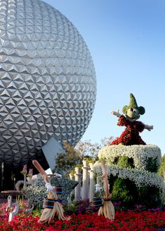 Sorcerer Mickey Topiary in front of Spaceship Earth at Epcot Center, Walt Disney World, FL