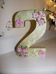 Pretty number decoration at a Tinkerbell fairy birthday party! See more party planning ideas at CatchMyParty.com!